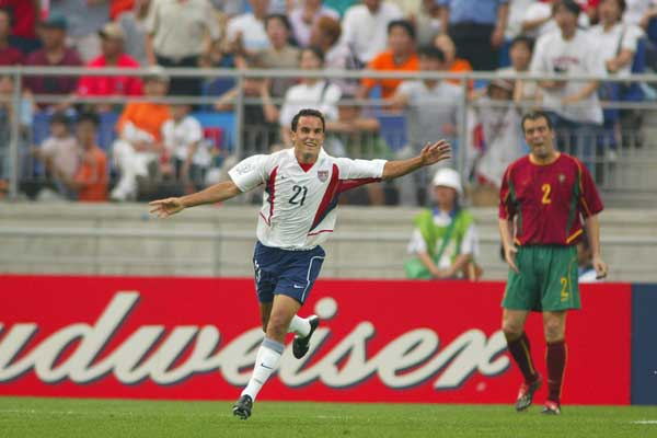 US National Team player Landon Donovan scores against Portugal during the 2002 World Cup.  Credit: John Todd - ISIPhotos.com