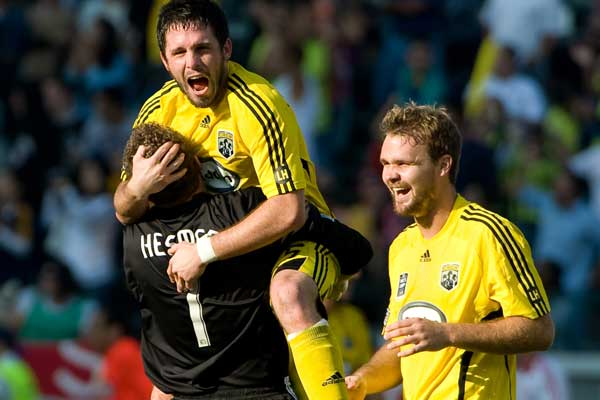 Will Hesmer celebrates with Columbus teammates Danny O'Rourke and Chad Marshall during the 2008 MLS Cup final.  Credit: John Todd - ISIPhotos.com