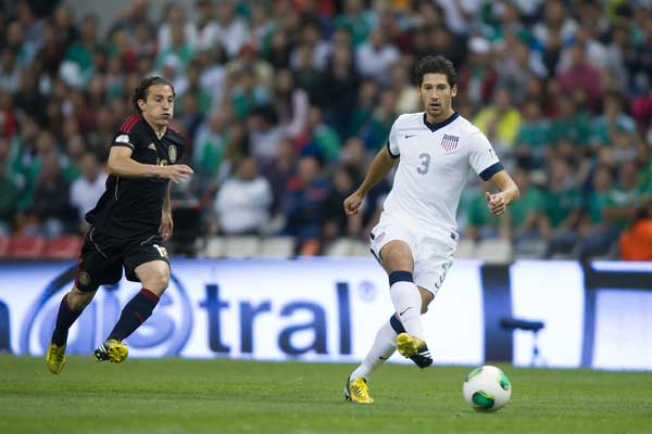 USA defender Omar Gonzalez on the ball against Mexico.  Credit: John Todd - ISIPhotos.com