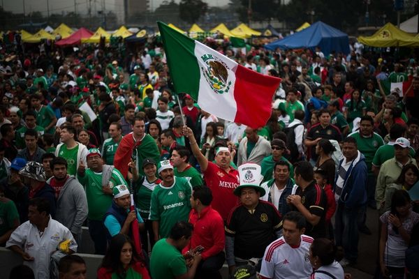 Mexico fans at Azteca before the Mexico - USA qualifier. Credit: Don Feria - ISIPhotos.com