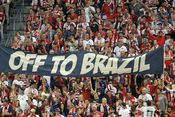 The USA support celebrates qualifying for the 2014 World Cup. Credit: Bill Barrett - ISIPhotos.com