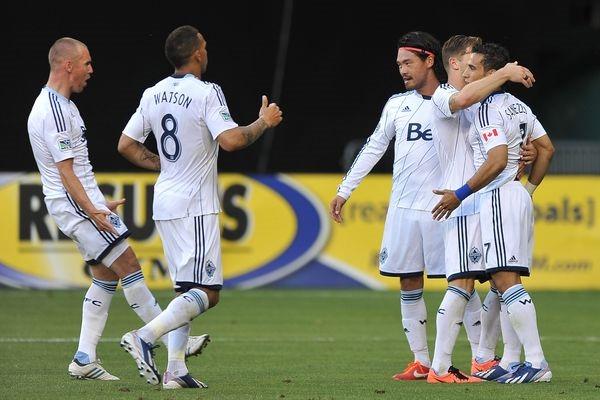 The Whitecaps celebrate a Camilo goal. Credit: Jose L. Argueta - ISIPhotos.com