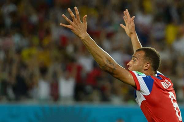 USMNT player John Brooks celebrates his goal against Ghana in the 2014 World Cup. Credit: John Todd - ISIPhotos.com
