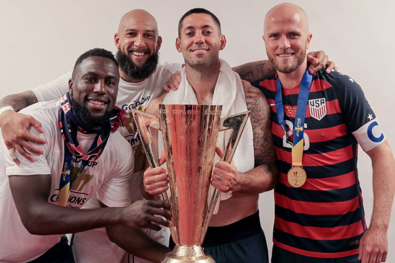 USMNT players Jozy Altidore, Tim Howard, Clint Dempsey, and Michael Bradley with the 2017 Gold Cup trophy.