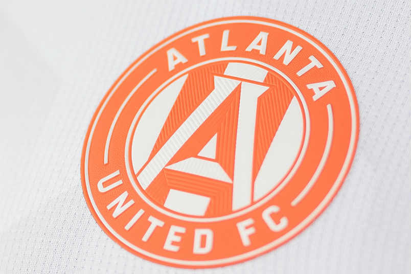 Atlanta United peach colored badge.