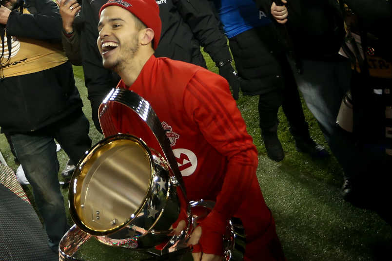 Toronto FC player Seb Giovinco holding the 2017 MLS Cup.