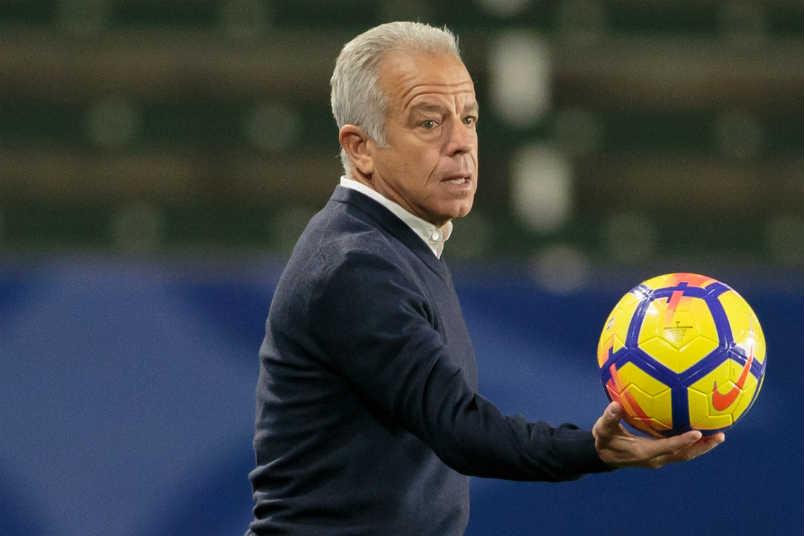 USMNT interim coach Dave Sarachan with soccer ball.