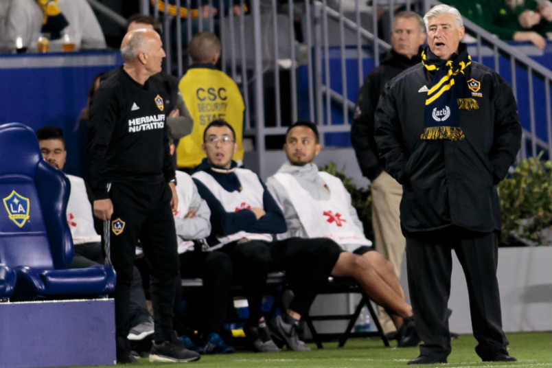 LA Galaxy coaches and the bench during an MLS game.