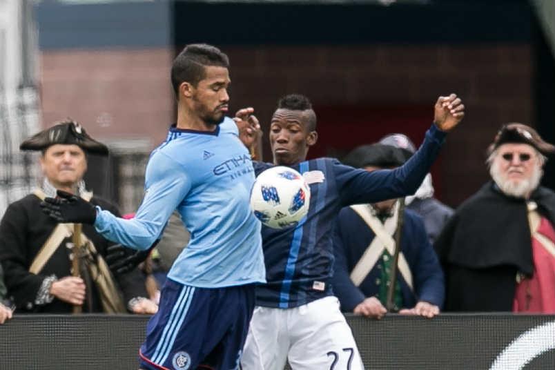 NYCFC's Yangel Herrera and New England's Luis Ciacedo.