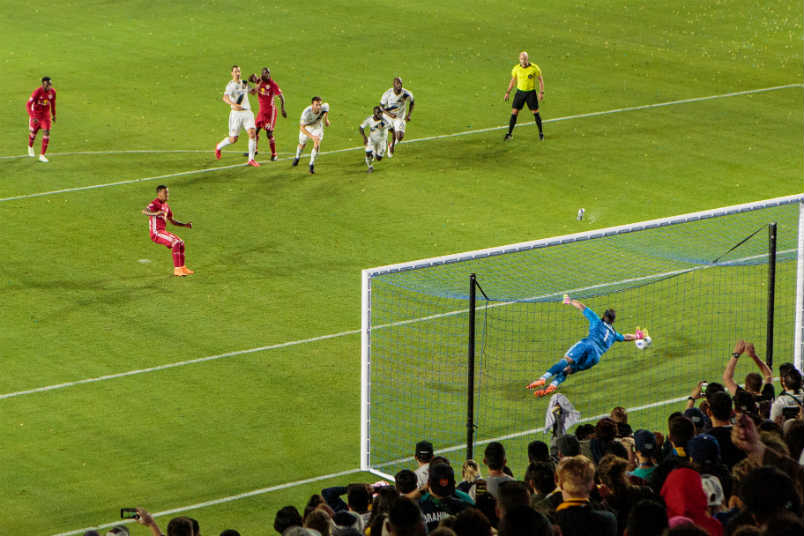 Red Bulls player Kaku converts a penalty.