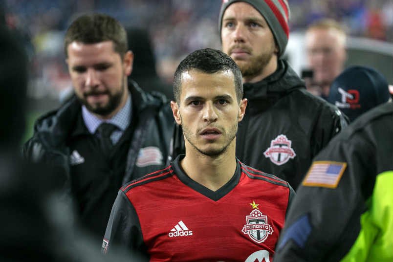 Seb Giovinco leaves with a red card for Toronto.