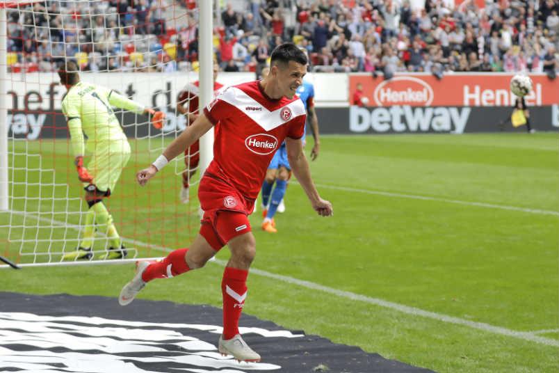 Alfredo Morales celebrates a goal for Fortuna Dusseldorf