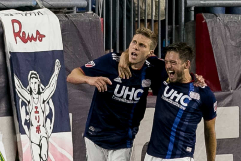 New England Revolution players Scott Caldwell and Kelyn Rowe