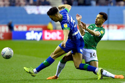 Robinson's Wigan Athletic wins in the Championship, Dorados advances