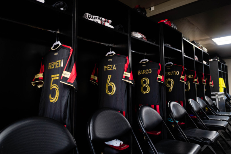atlanta united locker room with jerseys hanging