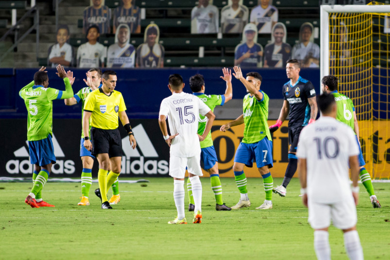 seattle celebrates a goal against the galaxy