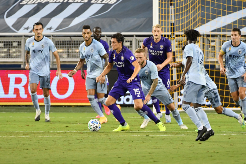 action from sporting kc vs orlando city with rodrigo schlegel on the ball
