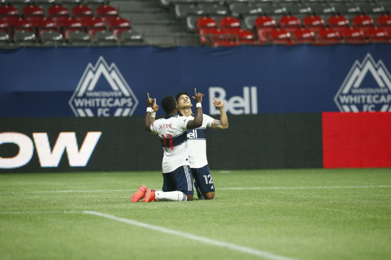 whitecaps players celebrating a goal against Montreal