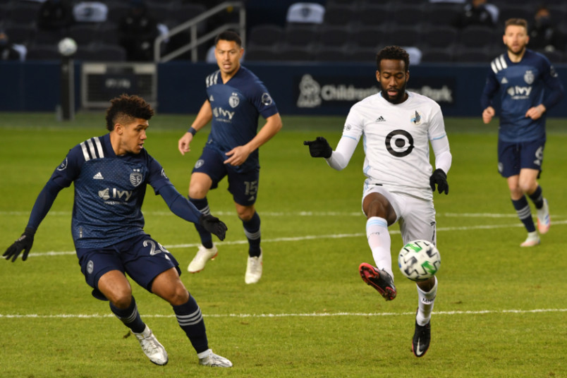 action from sporting kansas city vs minnesota united with kevin molino on the ball