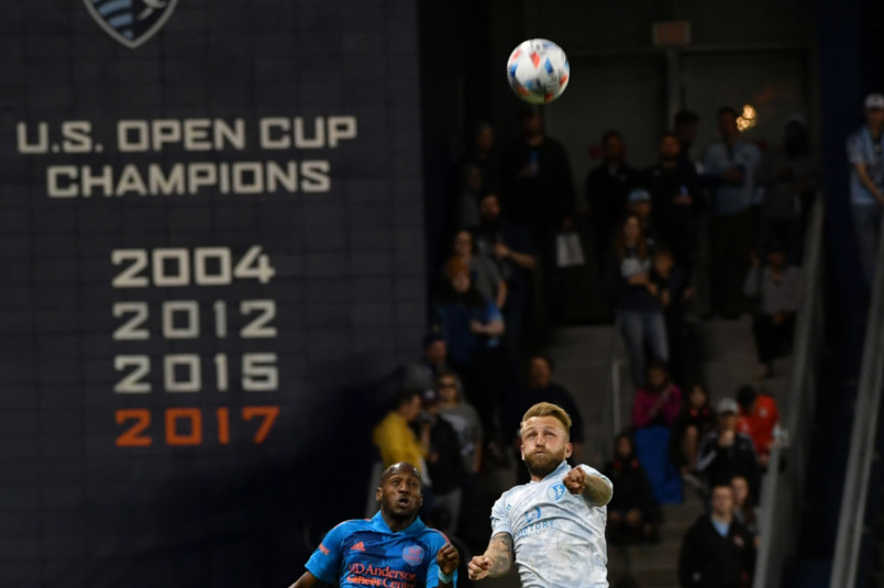 sporting johnny russell heads the ball