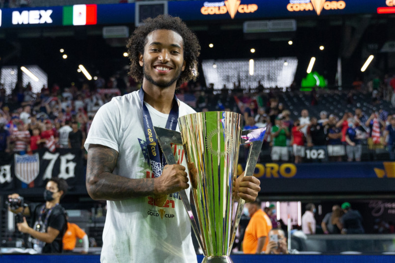 gianluca busio holding the gold cup trophy
