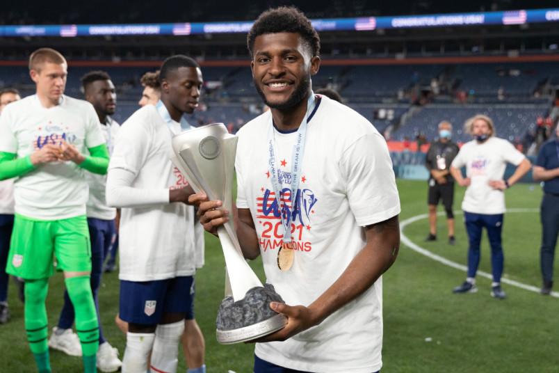mark mckenzie holding nations league trophy