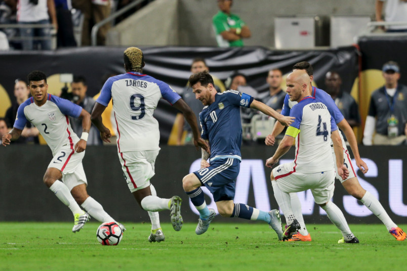 lionel messi surrounded by usmnt players during the copa centenario