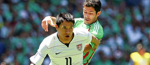 Ching and Israel Castro during the Mexico - USA World Cup Qualifier at Azteca Stadium.. Credit Osvaldo Aguilara - ISIPhotos.com