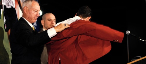 Jeff Agoos gets help from his father as he puts on his Hall of Fame sport coat during the 2009 induction ceremony. Credit: Howard C. Smith - ISIPhotos.com