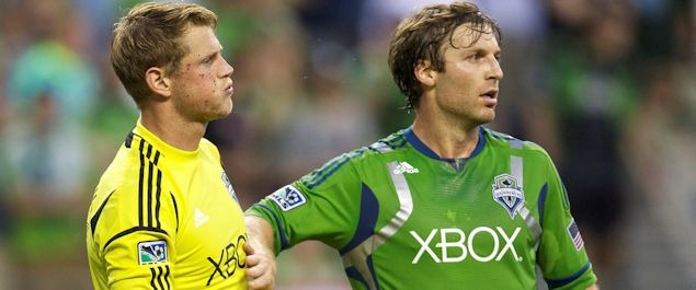 Seattle Sounders goalkeeper Bryan Meredith and teammate Jeff Parke.  Seattle beat Colorado 2-1 on July 7th.  Credit: Stephen Brashear - ISIPhotos.com