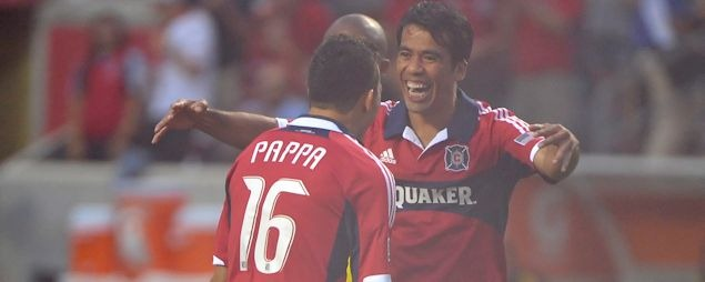 Pavel Pardo and Marco Pappa celebrates a Chicago goal in the 2-1 win on June 23rd.  Credit: Tracy Allen - ISIPhotos.com